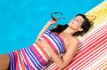 Sunbathing at poolside Royalty Free Stock Photography