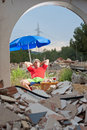 Sunbathing in the rubble guy surrounded by construction a real estate crisis concept Royalty Free Stock Image