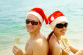 Sunbathing Santas Royalty Free Stock Images