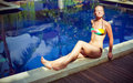 The sunbathing woman near a swimming pool Stock Images