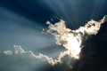 Sunbeam through the black stormy cloud Royalty Free Stock Photo