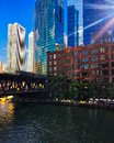 Sunbeams extend over Chicago cityscape and Chicago River during colorful summer evening. Royalty Free Stock Photo