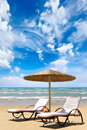 Sunbed on the beach vacation and tourism concept Stock Images