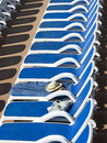 Sunbed reserved a with towel and hat Royalty Free Stock Image