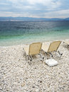 Sunbeds at beach of Kassiopi, Corfu, Greece Royalty Free Stock Image