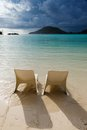 Sunbeds on the beach in seychelles a background cloudy sky Royalty Free Stock Images