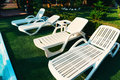Sunbeds empty near a pool Stock Image
