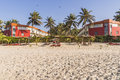 Sunbeds and hotel on the tropical beach on the atlantic ocean in gambia africa Royalty Free Stock Photos