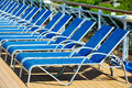 Sunbeds a lot of blue in a row Royalty Free Stock Photos