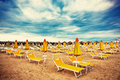 Sunbeds and parasols on the beach Royalty Free Stock Photography