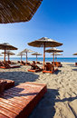 Sunbeds and parasols on the beach morning Royalty Free Stock Photography