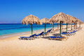Sunbeds on Plaka beach, Naxos island Royalty Free Stock Photo