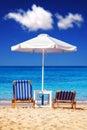 Sunbeds at Plaka beach on Naxos island Royalty Free Stock Photo
