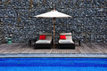 Sunbeds beside the pool Royalty Free Stock Photos