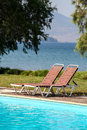 Sunbeds by the pool Royalty Free Stock Photo