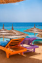 Sunbeds in a shadow empty on the beautiful tranquil beach sinai sharm el sheikh Stock Images