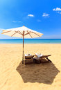 Sunbeds and umbrella on the beach Stock Photo