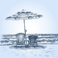 Sunbeds and umbrella on the beach Royalty Free Stock Photo