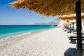 Sunbeds and umbrellas on the beautiful beach kaladhakia on the aegean island samos Royalty Free Stock Images