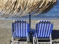 Sunbeds at Vlichada beach, Santorini, Greece. Royalty Free Stock Photo