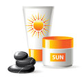 Sunblock cream creams and spa stones Royalty Free Stock Image