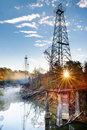 Sunburst oil derricks Stock Photography