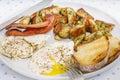 Sunday breakfast indulgent of bacon potato hashbrowns sunny side eggs and sourdough toast Stock Photography