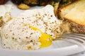 Sunday breakfast indulgent of bacon potato hashbrowns sunny side eggs and sourdough toast Stock Image