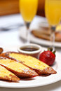 Sunday brunch with french toast and mimosas Stock Photos