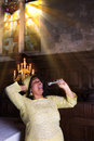 Sunday gospel singer during mass with sunshine through the stained glass windows of a medieval church Stock Photo