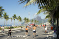 Sunday morning ipanema beach rio de janeiro brazil residents exercising on a car free street Royalty Free Stock Images