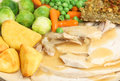 Sunday roast chicken dinner with vegetables stuffing and gravy Royalty Free Stock Image
