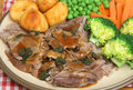 Sunday roast lamb dinner plate with vegetables gravy and mint sauce Stock Image