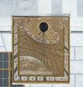 Sundial on the facade of a house Stock Photos