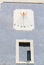 Sundial on the wall of the old castles in europe Stock Photo