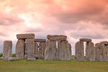 Sundiwn at stonehenge historic site stonehenge is a unesco worl world heritage in england with origins estimated bc Stock Photography