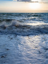 Sundown and surf at Dead Sea in winter evening Royalty Free Stock Photo