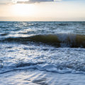 Sundown and surf at Dead Sea in winter twilight Royalty Free Stock Photo
