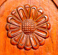 The sunflower carve wall on wood Stock Photos