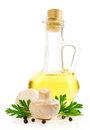 Sunflower oil in a glass bottle with mashrooms and parsley on white Stock Photo
