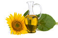 Sunflower and oil in glass decanter Royalty Free Stock Photo