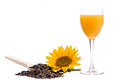 Sunflower with seeds and orange juice on w hite background Royalty Free Stock Image