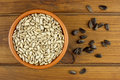 Sunflower seeds in the small  bowl on the wooden background Royalty Free Stock Photo