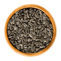 Sunflower seeds in wooden bowl Royalty Free Stock Photo