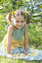 Sunflower smile beautiful smiling girl in a dress sits in a field of sunflowers Royalty Free Stock Photography