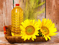 Sunflowers and a bottle of vegetable oil