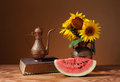 Sunflowers in a vase and fresh watermelon Royalty Free Stock Photo