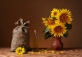 Sunflowers in a vase and a sack of jute Royalty Free Stock Photo