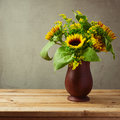 Sunflowers on wooden vase for Thanksgiving holiday table Royalty Free Stock Photo