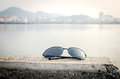 Sunglass and lake side city background travel Stock Photography